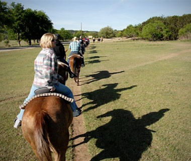 family horseback riding at Mayan Dude Ranch, Bandera, TX