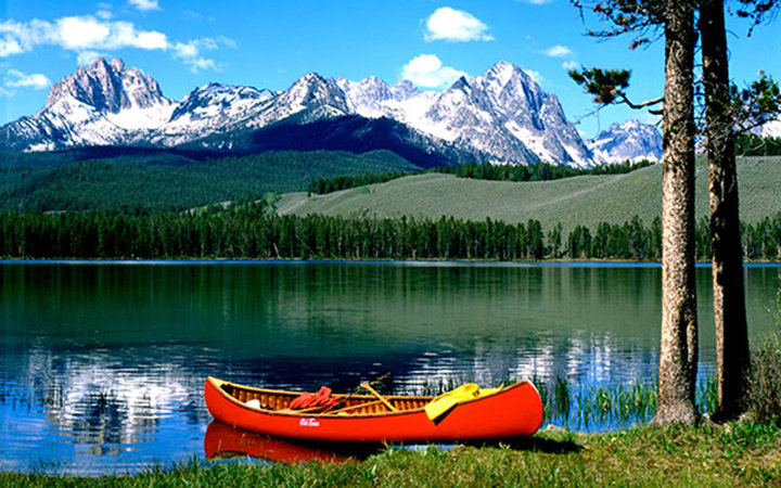 red canoe on scenic Redfish Lake in Stanley, ID