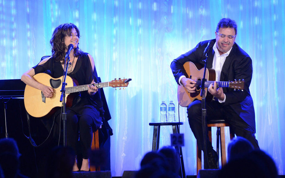 BEVERLY HILLS, CA - APRIL 10: Singers/Musicians Amy Grant and Vince Gill perform at The Kaleidoscope Ball – Designing the Sweet Side of L.A. benefiting the UCLA Children's Discovery and Innovation Institute at Mattel Children's Hospital UCLA held at B