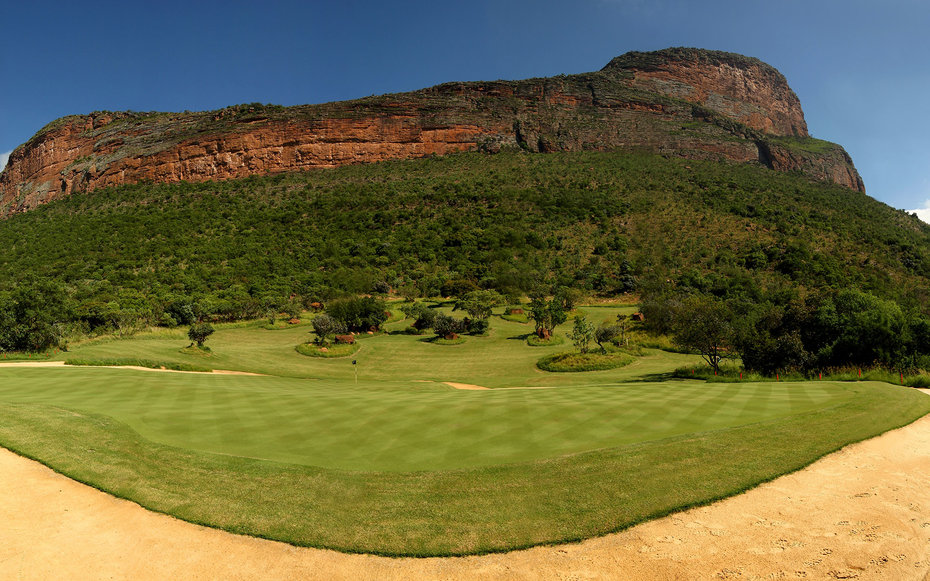 ENTABENI, SOUTH AFRICA - JANUARY 06:  (EDITORS NOTE, THIS IMAGE IS A DIGITAL PANORAMIC COMPOSITE) A 180 degree view of the Extreme 19th hole, Par 3 631m long, where the tee is at the top of Hanglip mountain and the green is the shape of Africa at the Lege