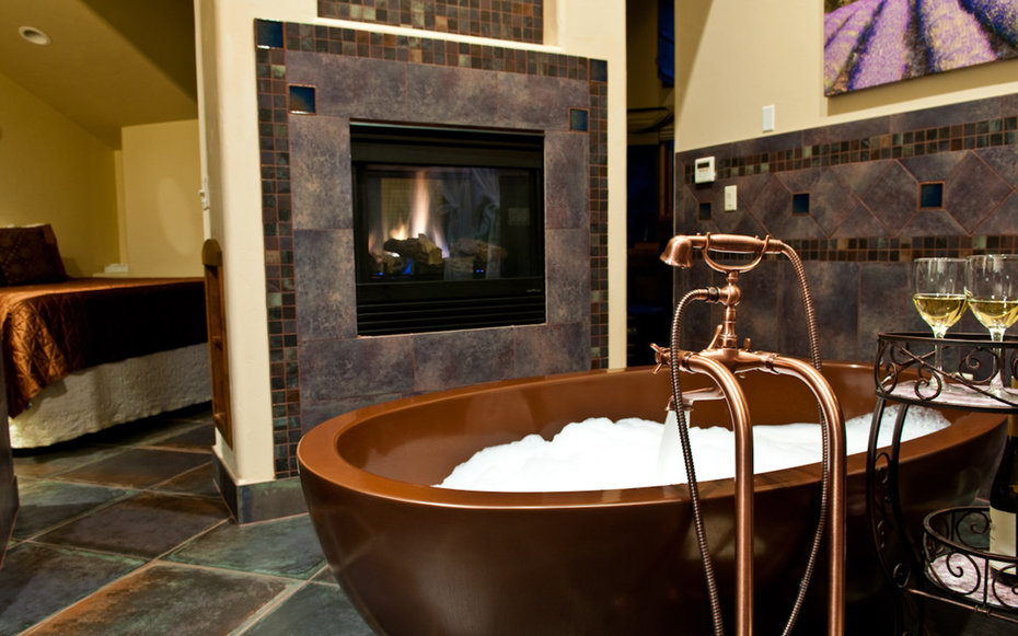 tub and fireplace at Della Terra Mountain Chateau in Estes Park, CO