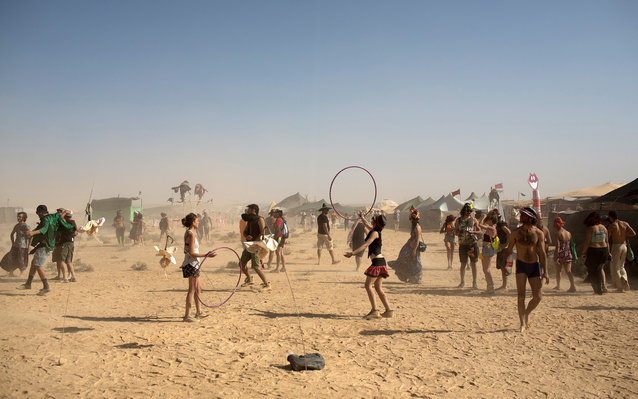 Israelis dance during the 2015 Midburn festival in the Negev Desert near the Israeli kibbutz of Sde Boker on May 21, 2015. Some 6000 Israelis and foreigners attended the five days of the Midburn festival, the Israeli version of the popular Burning Man fes