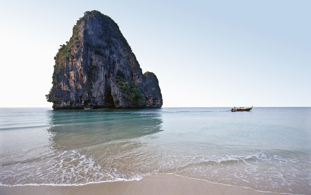 Krabi Province, island and longtail boat.
