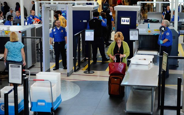 LOS ANGELES, CA - MAY 02:  Transportation Security Administration (TSA) agents screen passangers at Los Angeles International Airport on May 2, 2011 in Los Angeles, California. Security presence has been escalated at airports, train stations and public pl
