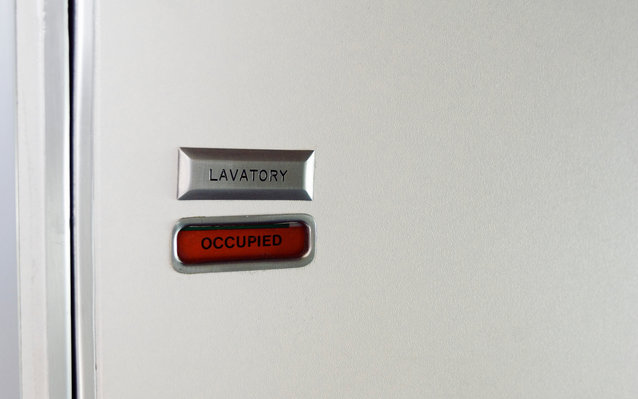 Occupied airplane lavatory