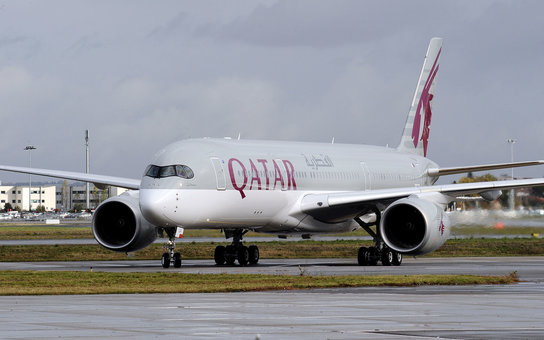 A photo taken on December 11, 2014 shows the first Airbus A350 bearing the Qatar airline company logo on the tarmac of Toulouse Blagnac airport.   AFP PHOTO / REMY GABALDA        (Photo credit should read REMY GABALDA/AFP/Getty Images)