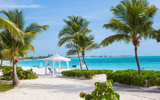 LONG ISLAND, THE BAHAMAS - JUNE 15: Pavillon, sunbeds, coconut palm trees and the beach of  luxury Resort and Hotel Cape Santa Maria which is having one of the Bahamas´ best beaches with white sand and palmtrees in Cape Santa Maria on June 15, 2012 in Lo