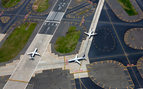 Aerial view of planes on runway