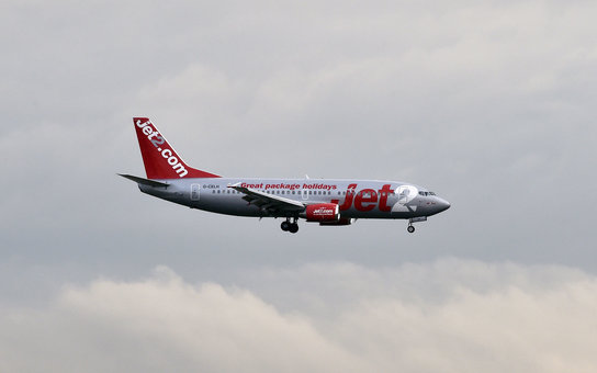 A Jet2 aircraft lands at the Toulouse-Blagnac airport on September 29, 2014. AFP PHOTO / PASCAL PAVANI        (Photo credit should read PASCAL PAVANI/AFP/Getty Images)