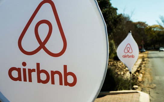 The logos of Airbnb Inc. sit on banners displayed outside a media event in Johannesburg, South Africa, on Monday, July 27, 2015. Airbnb is hoping to spread its unique brand of hospitality throughout Africa. Photographer: Waldo Swiegers/Bloomberg via Getty