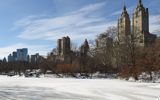 NEW YORK, NY - JANUARY 24:  A man sits by an ice covered lake in Central Park on January 24, 2016 in New York, City. Most of New York's streets were cleaned up over night after a huge snow storm slammed into the mid Atlantic states including New York. (Ph