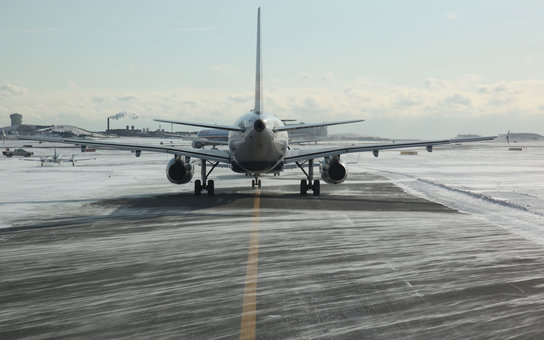 Airplane line up in snowy