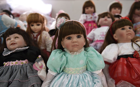 """Luuk thep"" (child angels) dolls are displayed at the Economic Crime Suppression Division after more than a hundred of them were seized in separate raids, in Bangkok on January 26, 2016. 