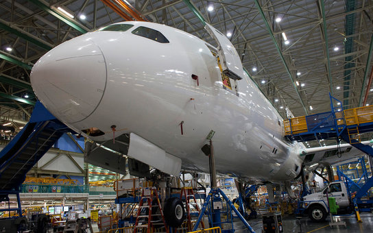 The nose of a 787 airplane is seen during the manufacturing process at the Boeing Co. facility in Everett, Washington, U.S., on Monday, June 1, 2015. Flow, a measure of the time needed to put together 787s in Washington and South Carolina, has dropped by