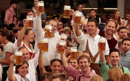 MUNICH, GERMANY - SEPTEMBER 19:  Revelers raise their beer glasses at the Paulaner beer tent on the opening day of the 2015 Oktoberfest on September 19, 2015 in Munich, Germany. The 182nd Oktoberfest will be open to the public from September 19 through Oc