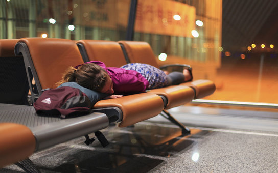 Sleeping female at airport