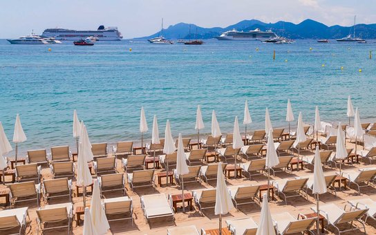 France, Cote dAzur, Cannes, sun loungers and beach umbrellas on beach