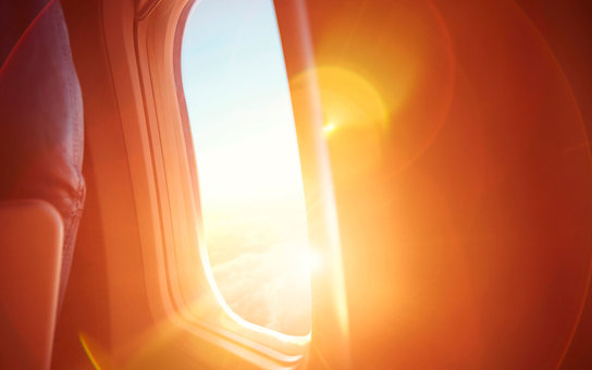 Sunrise through a plane window.