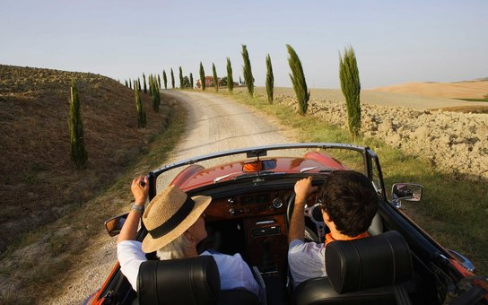 Vintage car on a country road at the Montalcino region, Tuscany, Italy, Europe