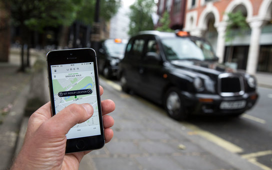 LONDON, ENGLAND - JUNE 02: In this photo illustration, a smartphone displays the 'Uber' mobile application which allows users to hail private-hire cars from any location on June 2, 2014 in London, England. The controversial piece of software, which is opp
