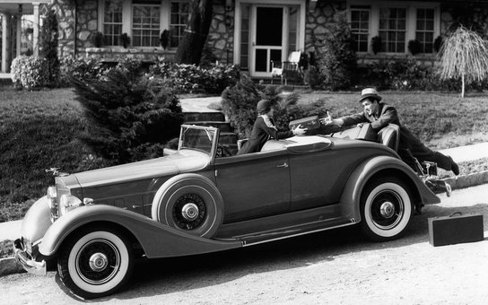 1930s WOMAN IN CAR PACKARD HANDING SUITCASE TO MAN