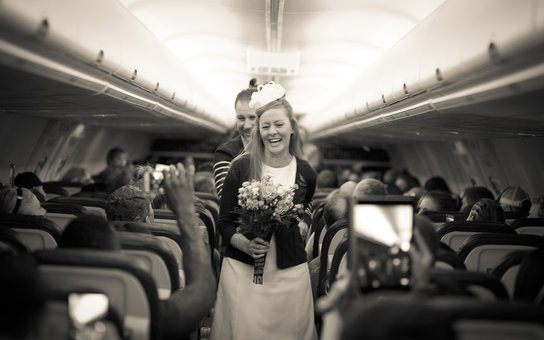 Mid-flight wedding on airplane