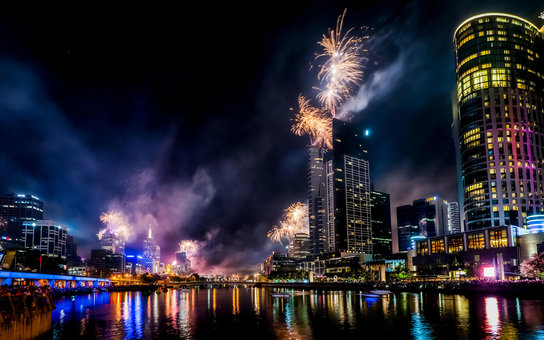 Spectacular fireworks along the Yarra River light up the night sky over Melbourne Australia.